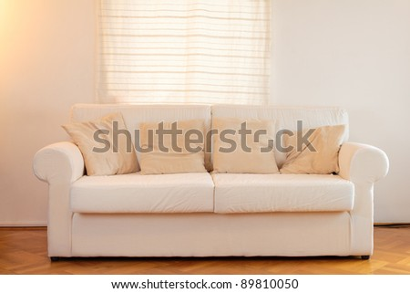 White sofa in a modern home - stock photo