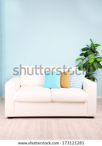 White sofa in room on blue background - stock photo
