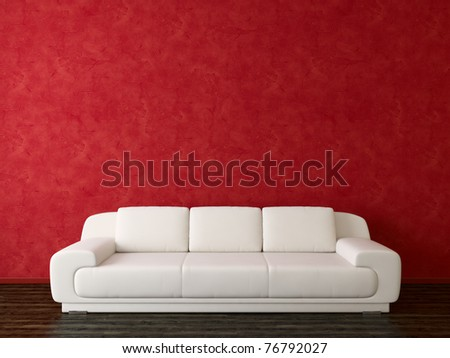 White sofa on red stucco background - stock photo