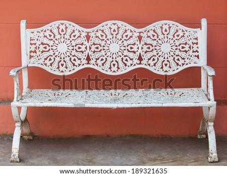 White sofa orange walls - stock photo