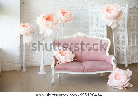 White Sofa With Pretty Pink Fabric Upholstery In A Room With Wooden Floor  And White Walls