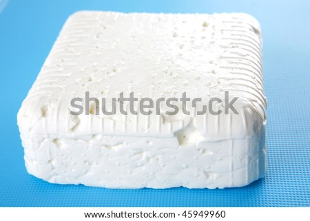 white soft feta cheese on plate over white