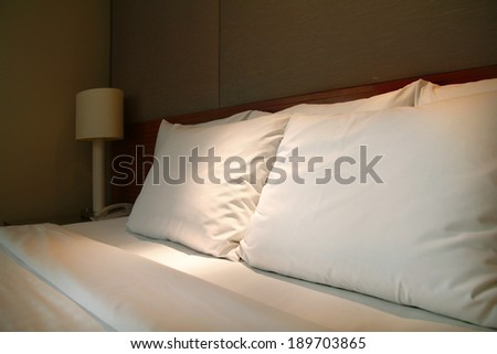 white soft pillows on bed in private bedroom