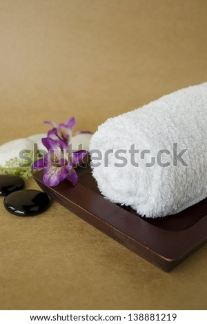 white spa towel roll on wooden tray with orchid - stock photo