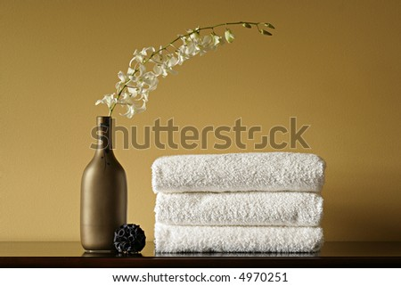 White Spa Towels with Flowers in Vase - stock photo