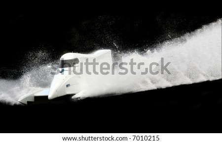 White speed boat on black F1 - stock photo