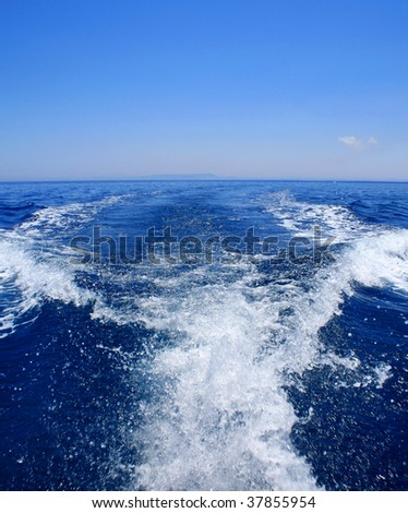 white speedboat wake on blue sea - stock photo