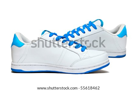 White sport shoes isolated on white background - stock photo
