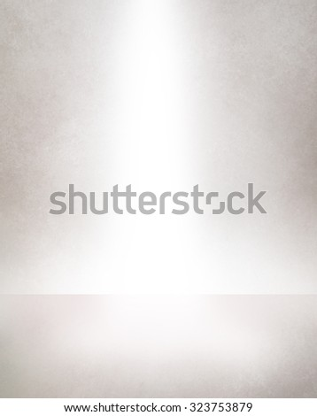 white spotlight background, product display showcase, empty room with interior floor and wall in pale neutral gray color with bright white lighting - stock photo