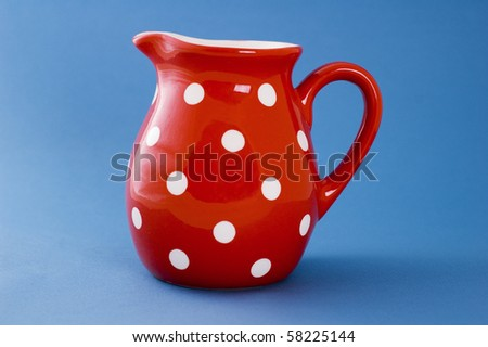 white spotted red jug - stock photo