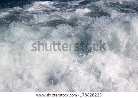 White spray of sea waves on the shore of the Black Sea - stock photo