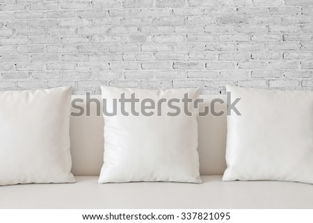White square pillow on white sofa - stock photo