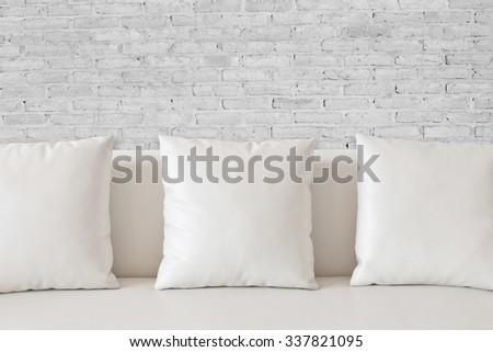 White square pillow on white sofa - stock photo