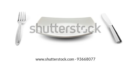 white square plate, knife and fork cutlery isolated with clipping paths included - stock photo