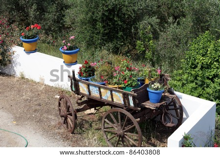 White stairs decorated with red flowers in blue pots Zia Island of Kos Greece - stock photo