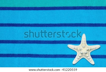white starfish on beach towel room for your text - stock photo