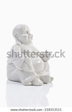 White statue of Buddha, close up - stock photo