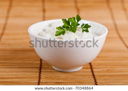 White steamed rice in a white bowl