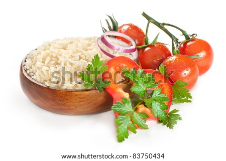 White steamed rice in wooden round bowl  with tomatoes - stock photo