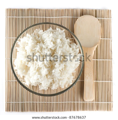 White steamed rice on bamboo background - stock photo