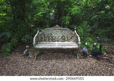 White steel chair in classic style at garden park. - stock photo