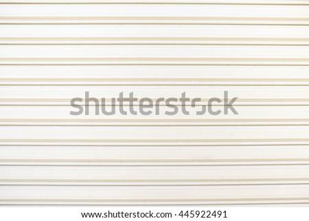 White steel roller shutter door background - stock photo