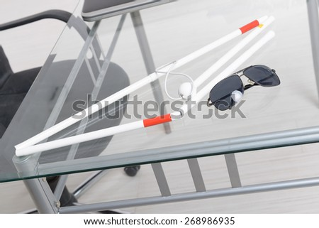 White stick and dark glasses for blind person - stock photo
