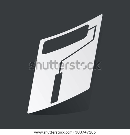 White sticker with black image of paint roller, on black background - stock photo