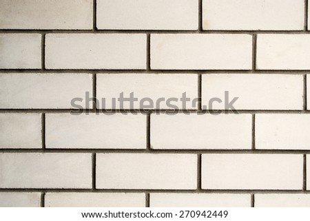 White stone brick cement wall with grey cement - stock photo