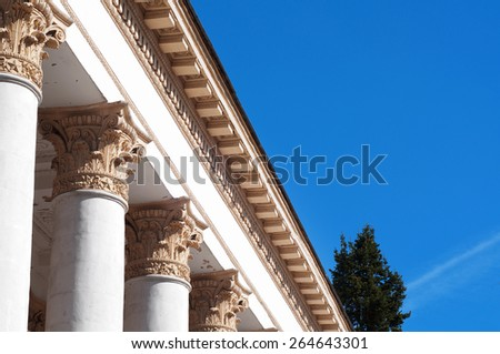 White stone columns standing in a row - stock photo