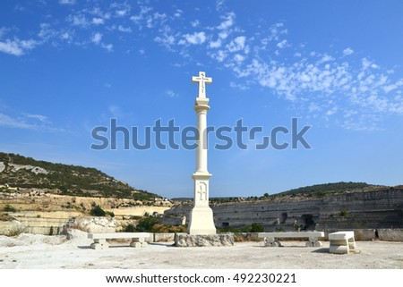 White stone cross on Monastery rock in Inkerman, Crimea, Russia.