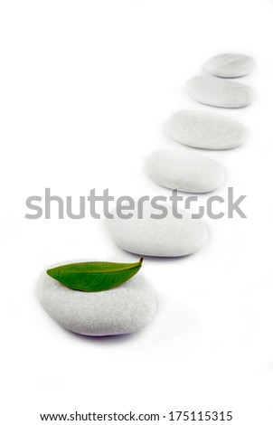 white stone pebble zen path isolated on white - stock photo
