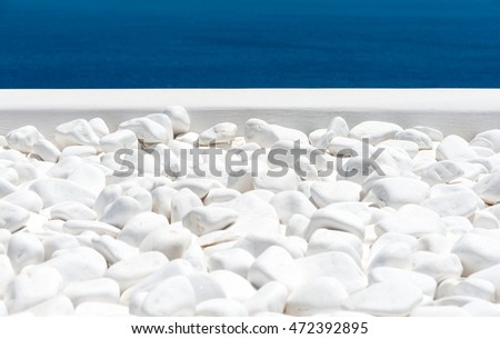 White stone texture with sea in Santorini - Greece