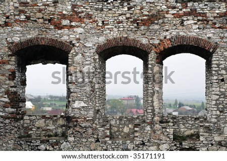 White stone wall, visible three windows without windshield. - stock photo