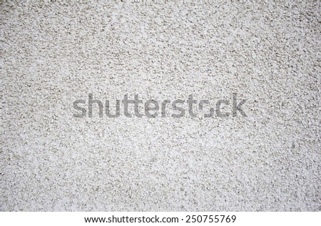 White stones in urban wall construction - stock photo