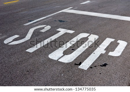 White stop sign on the road - stock photo