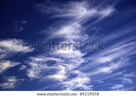 white streaky clouds blue sky in the back ground - stock photo