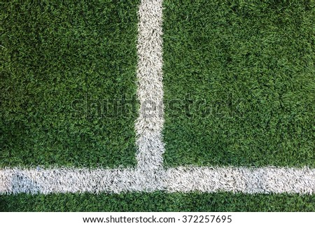 White Stripe Line on Artificial Green Soccer Field as Copyspace to input Text from Top View used as Template - stock photo