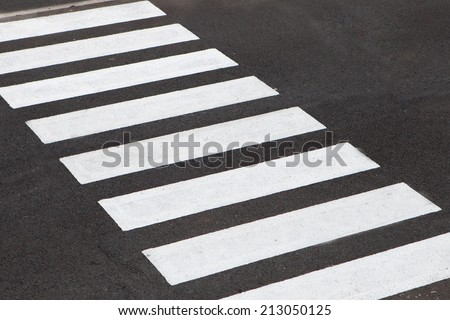 White stripes of a zebra crossing on the road - stock photo