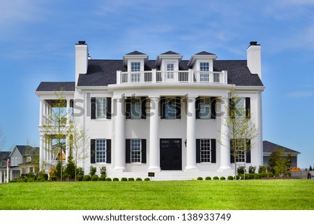 White Suburban American New England Style Dream Home with Large Front Porch  - stock photo