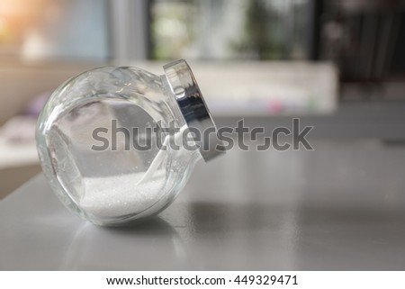 white sugar in bottle.