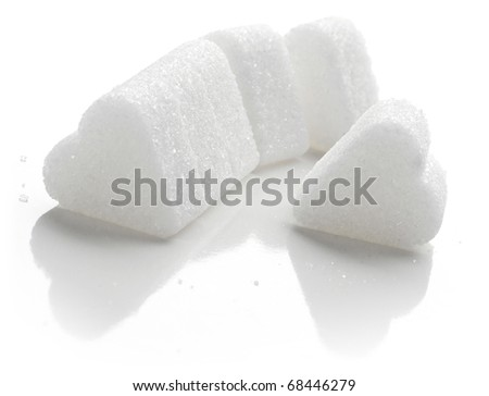 White Sugar in heart shape.. Isolated on white. - stock photo
