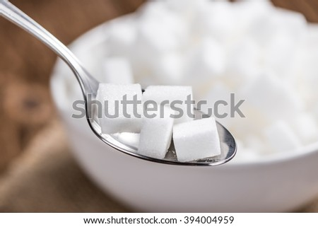 White Sugar (selective focus; close-up shot) on a vintage wooden background