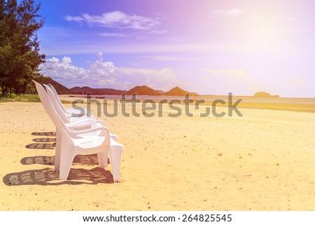 White sun chair on beach of Thailand. Vintage filter. - stock photo