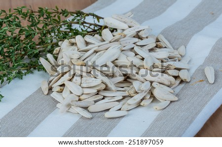 White sunflower seeds in the bowl on napkin - stock photo
