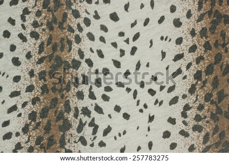 White synthetic fabric with black dot texture background