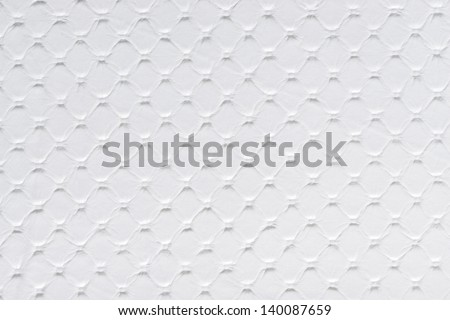 White synthetic leather with embossed texture background - stock photo
