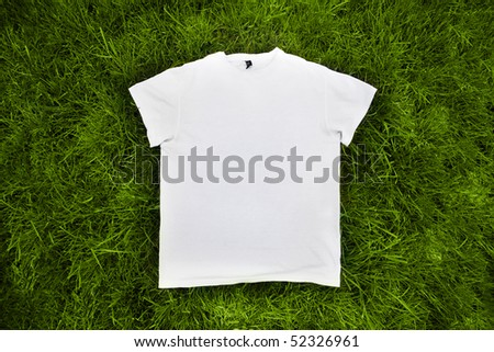 white t-shirt on the green grass