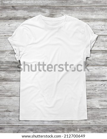 White t-shirt on wood floor - stock photo