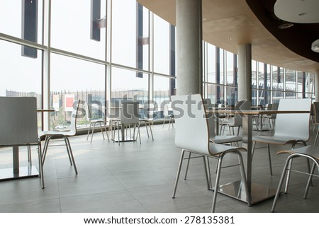 white table and chair in food court - stock photo